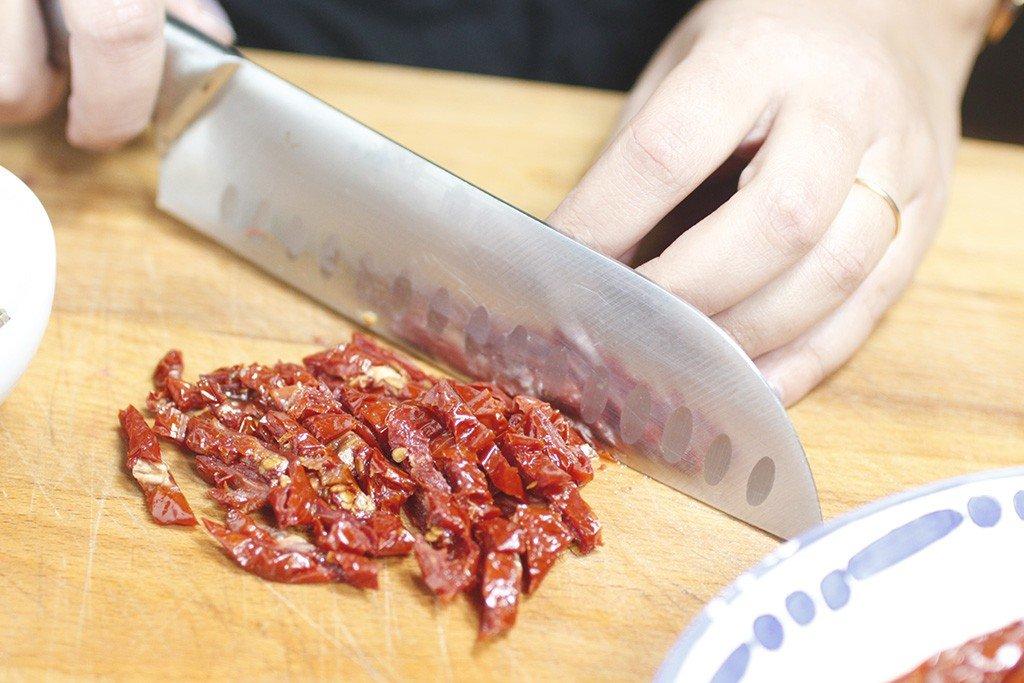 risotto acciughe, pomodori secchi e burrata